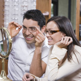 Couple adjusting glasses