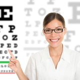 Woman With Glasses and Eye Exam