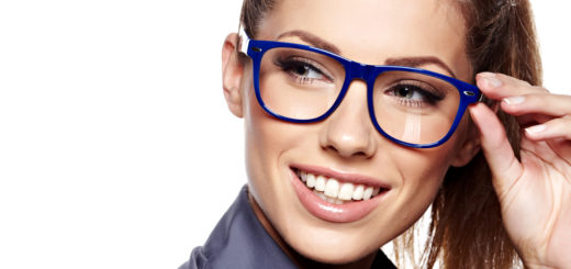 Woman wearing bright colored glasses