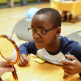 BGCA kid getting glasses adjusted