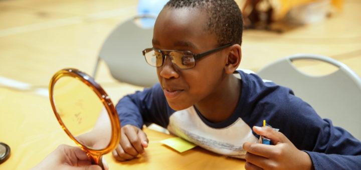 BGCA kid getting glasses adjusted